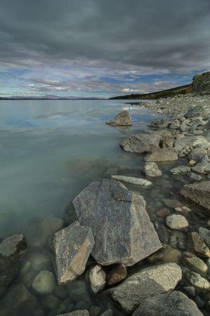 The Shoreline along Lake Pukaki near Mount Cook National Park on the South Island of New Zealand Stock Photo