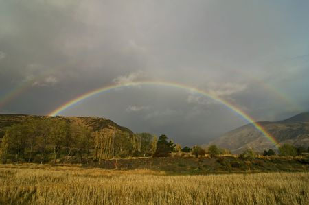 A Double Rainbow at Dusk near Queenstown, New Zealand
