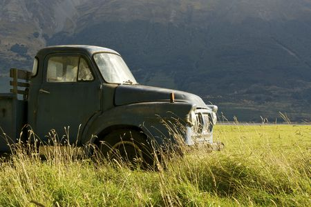 An old pickup truck in a grassy field Stock Photo