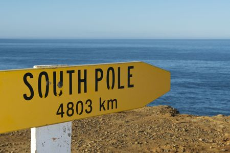 Sign Pointing to the South Pole from New Zealands most Southern Point