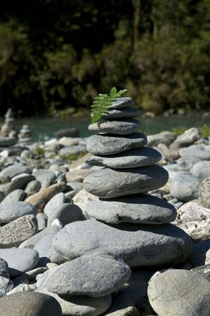 A Cairn or Stack of Rocks near a Riverside
