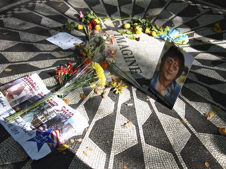 NEW YORK CITY - October 10: Flowers and Memorbilia are laid around John Lennons memorial at Central Parks Strawberry Fields on October 10, 2010 in New York City.