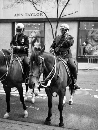 NEW YORK CITY, USA - October 11, 2010: Police Officers ready for the Columbus Day Parade on Fifth Avenue