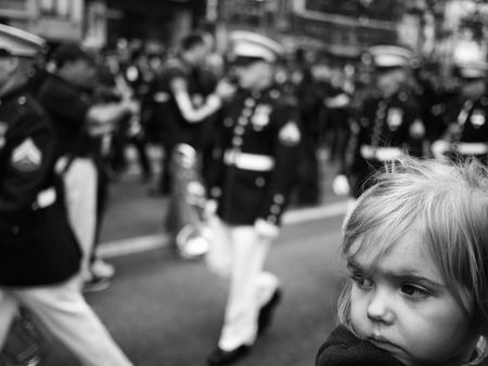 NEW YORK CITY, USA - October 11, 2010: A young girl watches the Columbus Day Parade on Fifth Avenue