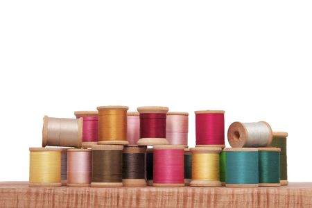Various Spools of Colorful Thread on a White Background
