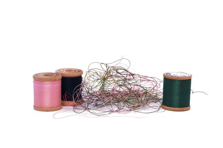 A Pile of Loose Thread and Spools on a White Background Stock Photo