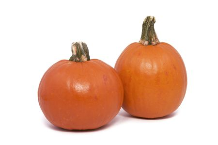 Two Small Pumpkins Isolated against a White Background Stock Photo