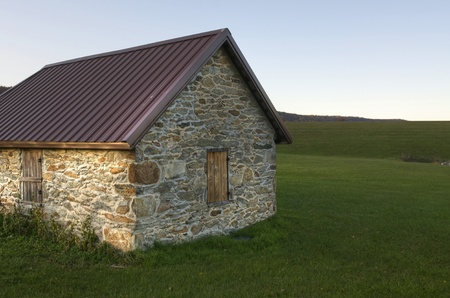An old stone building surrounded by green