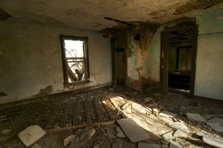 A Bedroom left in Rubble in an Abandoned House photo