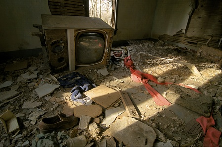 A Vintage Television is among the rubble in an Abandoned House Stock Photo