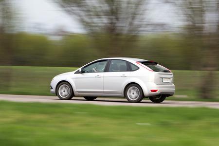 hatchback: Shiny silver modern hatchback car  Side view  Driver Stock Photo