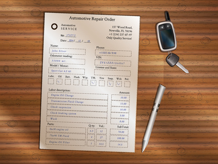 Filled automotive repair order form with remote alarm and ballpoint pen on wooden table.
