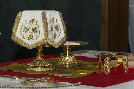 Holy Eucharist in orthodox church: Prepared for sanctification pieces of bread on paten and wine in covered chalice on Holy See