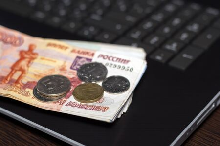 Money recount. Accounting for finance. Russian money on laptop.