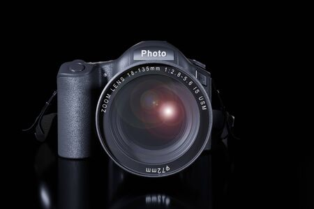 Front view of professional digital single lens reflex camera with a zoom lens and a strap on a black background with copy space. Realistic 3d render. Place for advertising text. Reflection at bottom