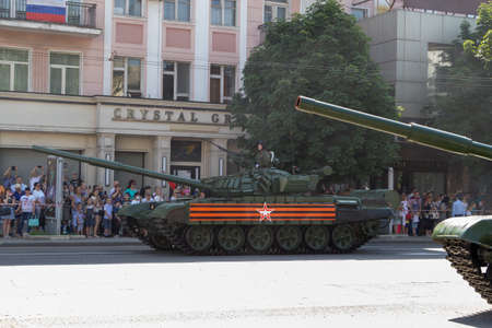Donetsk, Donetsk People Republic, Ukraine - June 24, 2020: Armored heavy Soviet tanks move along the main street of the city during the Victory Parade.