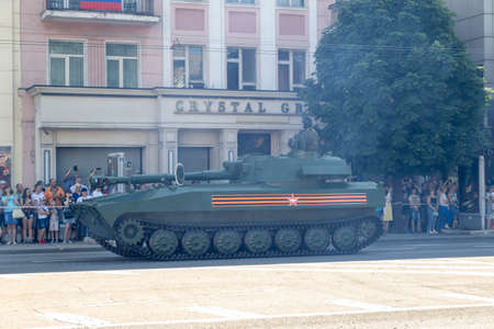 Donetsk, Donetsk People Republic, Ukraine - June 24, 2020: Self-propelled artillery mounts move along the main street of the city during the Victory Parade.