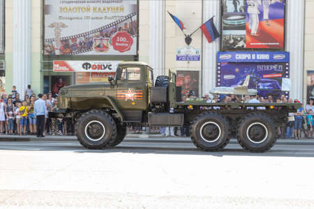 Donetsk, Donetsk People Republic, Ukraine - June 24, 2020: Military trucks with launchers for unmanned reconnaissance aircraft on board move along Artyom Street during the Victory Parade.