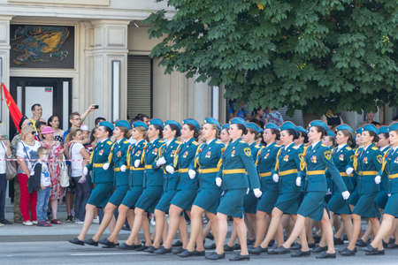 Donetsk, Donetsk People Republic, Ukraine - June 24, 2020: Women from the Ministry of Emergencies in full dress march along the main street of the city during the Victory parade.