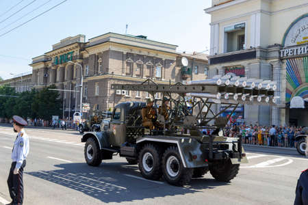 Donetsk, Donetsk People Republic, Ukraine - June 24, 2020: A column of Soviet multiple launch rocket systems Katyusha moves along Artyoma Street during the Victory Day parade in World War II.
