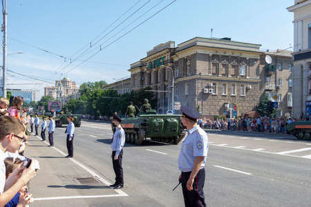 Donetsk, Donetsk People Republic, Ukraine - June 24, 2020: Landing vehicles with soldiers move along the main street of the city during the Victory Parade.