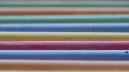 Selective focus on crayons for drawing on asphalt in different colors