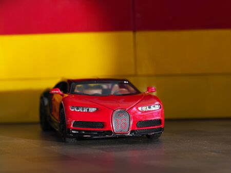 Children's toy sports car is on the table