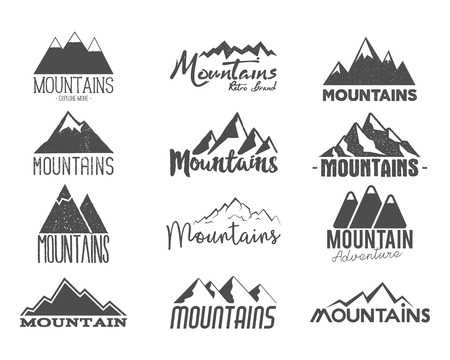 Set of Hand drawn mountains badges. Wilderness old style typography labels.