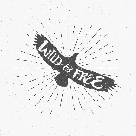 eagle badge: Vintage eagle with hand drawn lettering slogan. Retro silhouette monochrome animal design with inspirational typography. Motivation text. Wild and free style. Sunburst. Vector illustration. Illustration