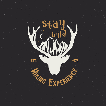 Hand drawn vintage camping badge and hiking label with wild animals design elements. Included deer head, mountains and quote text- stay wild . Old style patch. Stock template. Stock Photo