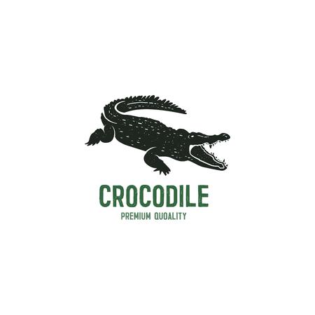 ワニのロゴのテンプレート。ワニ、クロコダイルのテキストのシンボル。