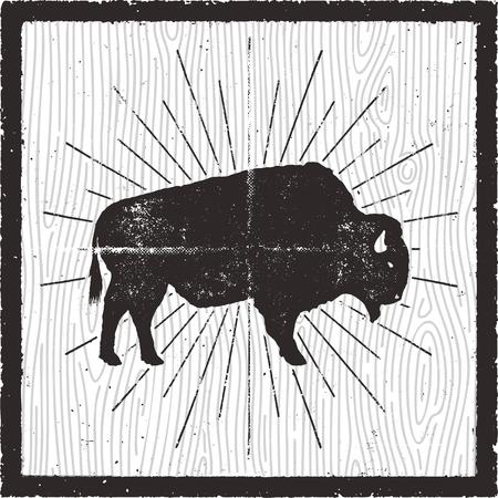 Siluetta dell'icona del bisonte. Effetto tipografico retrò. Simbolo di bufalo con spruzzi di sole isolato su carta di sfondo retrò. Utilizzare per steak house, infografica,. disegno vettoriale