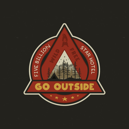 Hand drawn adventure logo with camp tent, mountains, pine trees forest and quote - Go outside, wild and free, five billion star hotel. Old style outdoors adventure emblem in retro style. Stock vector