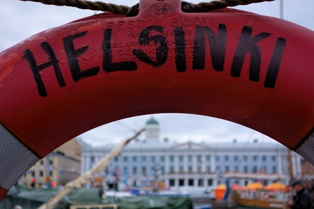 engel: The Market Square and the Helsinki City Hall seen through a life-buoy during an annual Baltic Herring Fair