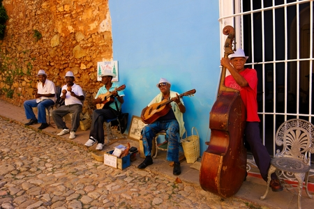 Trinidad, Cuba - December 24, 2013 - A street band playing hot salsa in the streets of historic Trinidad on Christmas Eve 2013.