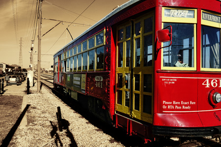 riverfront: New Orleans, USA - November 15, 2012 : Riverfront street car in New Orleans, USA on the tracks nearby the banks of the Mississippi river.
