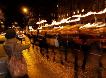 torchlight: Helsinki, Finland - December 6, 2013 - Finnish independence day torchlight procession 6 December 2013 at Arkadiankatu street in the center of Helsinki.