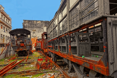 Rusty and old steam locomotives and freight cars abandoned in a yard in central Havana, Cuba