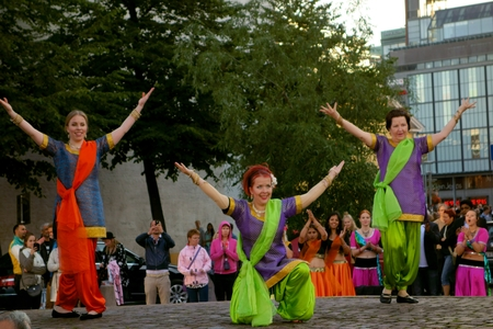 indian dance: Helsinki, Finland - August 21, 2014 - Dancers performing Indian dance at the Paasikivi Square in the center of Helsinki, Finland during annual Night of the Arts festival.