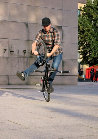 bmx bike: Helsinki, Finland - August 21, 2014 - Member of the Too Small Bikes crew showing impressive tricks on a BMX bike at the Night of the Arts festival in Helsinki, Finland. Editorial
