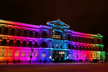 lux: Helsinki, Finland - January 10, 2016 - People watching Candy House light art installation by Sun Effects collective displayed on the exterior of Ateneum Art Museum at the Lux Helsinki light arts festival on 10 January 2016.