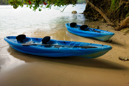 Two blue canoes on the beach at the small Monkey Island on the coast of Port Antonio in Portland, Jamaica.
