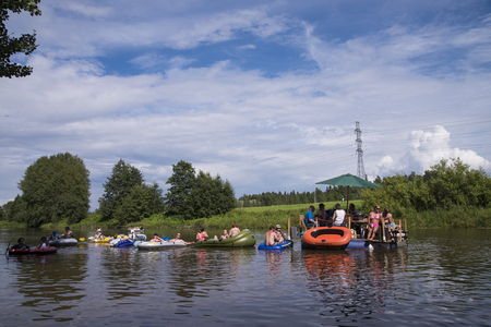 dinghies: HELSINKI %u2013 July 30, 2016 %u2013 Unidentified people drafting down Vantaanjoki river on rubber dinghies, rafts and other inflatables at the annual Kaljakellunta (Beer Floating) festival taking place at the end of the July or beginning of the August.