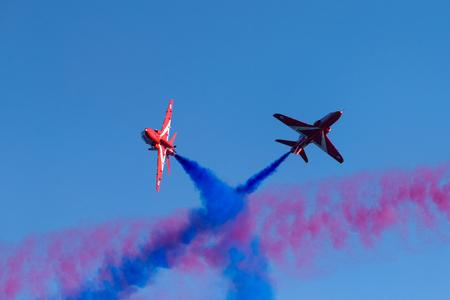 Helsinki, Finland - June 9, 2017: Red Arrows (The Royal Air Force Aerobatic Team) flying  aerobatics at the Kaivopuisto Air Show in Helsinki, Finland on 9 June 2017.