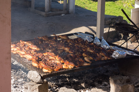 World famous Boston Bay jerk chicken cooking in the barbeque grill in Boston Bay in the East Coast