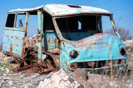 Rusty, old and abandoned Soviet Russian van out in the wasteland in rural Southern Armenia in Ararat province on 4 April 2017.