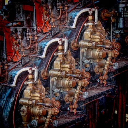 Tiled controls and other parts of a historic steam locomotives engine cabin.