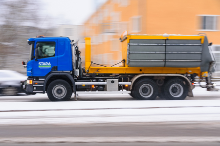Helsinki, Finland - November 23, 2017: Winter road maintenance truck spreading de-icing or road salt on a icy and snowy street in Helsinki, Finland for creating much more safe driving conditions. Standard-Bild - 126613593