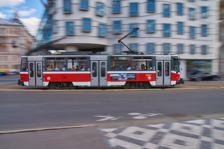 Prague, Czech Republic -  July 5, 2017: Prague line 5 tram travelling in high speed in front of world famous Dancing House building in Rasin Embankment on July afternoon. Standard-Bild - 126613635