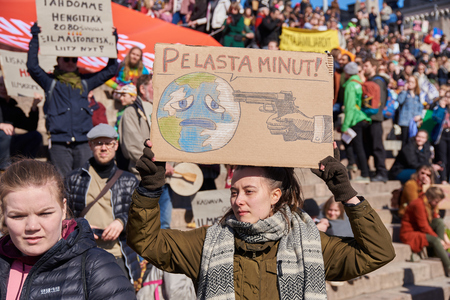 Helsinki, Finland - April 6, 2019: March and demonstration against climate change (Ilmastomarssi) in downtown Helsinki, Finland attended by more than 10000 people. Standard-Bild - 126613809